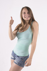 happy young woman showing thumbs up