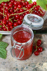 Red currant jelly in preserving glass
