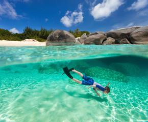 Little boy snorkeling in tropical water