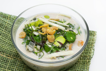 Coconut milk soup with gnetum gnemon and bamboo shoots,tropical