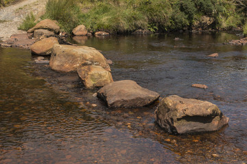large stepping stones on river