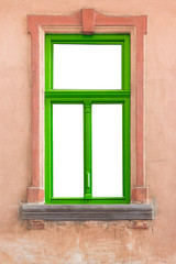 green window frame on old wall