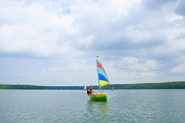 Sailing, Girl flows in a sailboat on the lake