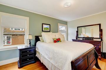 Aqua tone bedroom with wooden furniture