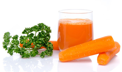Composition with a glass of carrot juice, fresh carrots and pars