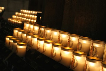 Glowing row of votive candles,Notre Dame Cathedral, Paris