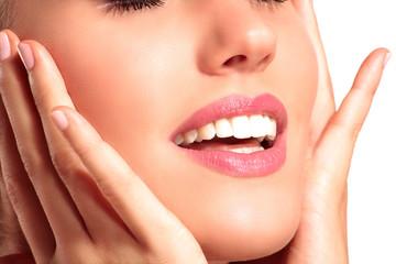 Closeup of a beautiful model touching her perfect skin face