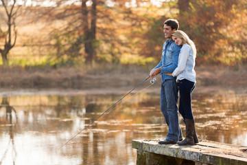 Printed kitchen splashbacks Fishing young couple fishing together