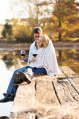 romantic couple snuggle outdoors in autumn