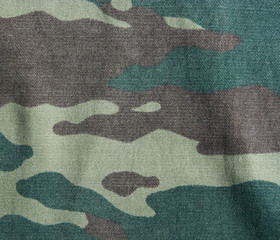 Camouflage texture. Background of a khaki  pattern.