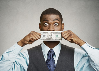 Shocked man with dollar bill curency covering his mouth