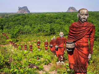Statues of Buddhist Monks in the Forest, Mawlamyine, Myanmar