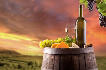 White wine with vineyard on background