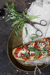 bruschetta with baked cherry tomatoes parmesan and rocket