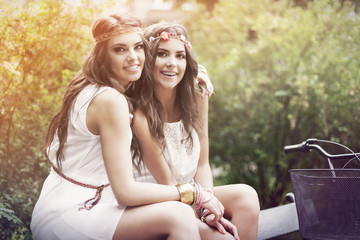 Two beautiful boho girl in the park