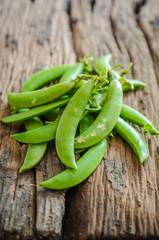 Green string bean on wooden floor