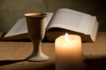 chalice of wine and bible
