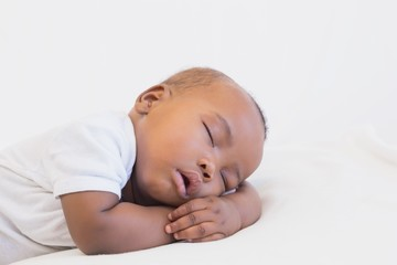 Adorable baby boy sleeping peacefully