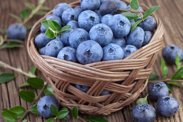 Basket of Blueberries on wooden background