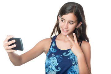 Young hispanic girl taking a self portrait