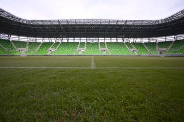 Empty green bleachers at stadium.