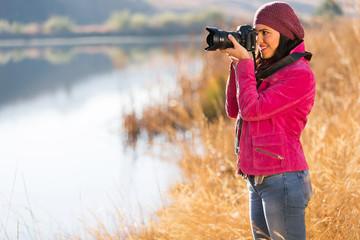 photographer take photos outdoors in autumn