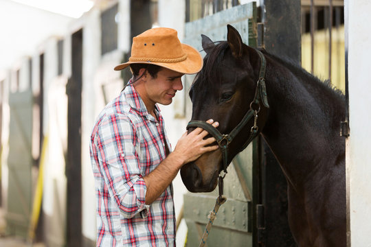 horse breeder comforting a horse