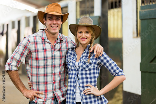 quotcowboy cowgirl couple inside stablesquot stock photo and