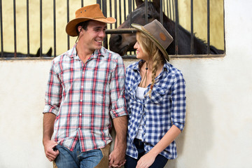 american western couple holding hands