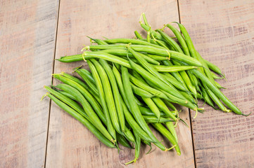 Fresh green beans on table