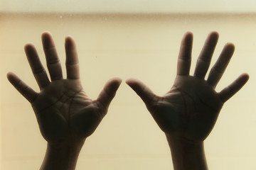Hands on glass