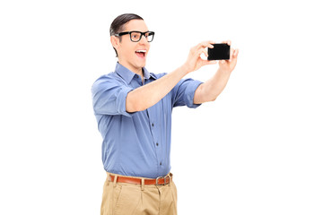 Happy guy taking a selfie with cell phone