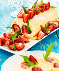 Swiss roll cake with strawberries