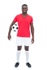 Football player in red jersey holding ball
