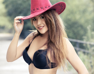 Portrair of young girl with hat and bra