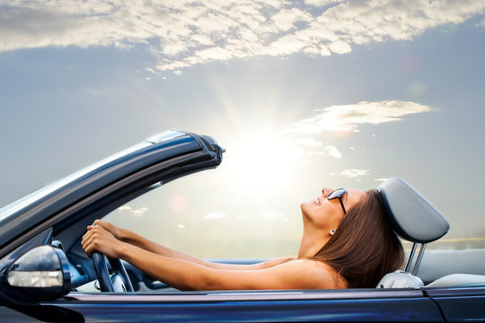 Young girl driving convertible