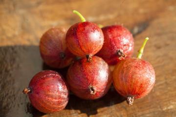 gooseberry - ripe garden berry on a wooden surface