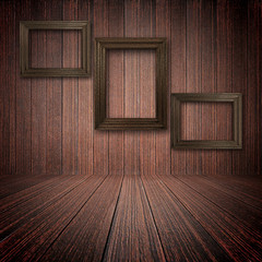 Wooden photo frames on the wall inside the room