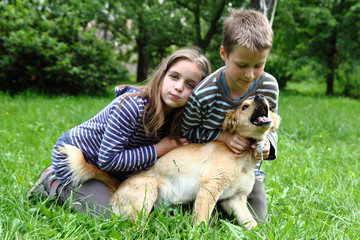 brother and sister and their dog