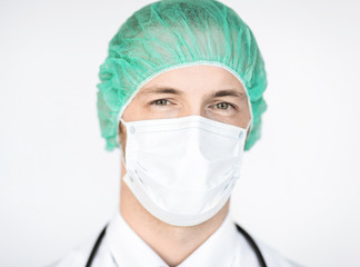 surgeon in medical cap and mask