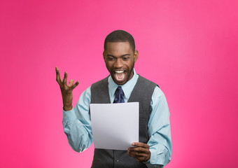 Excited happy man holding document, receiving good news