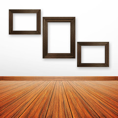 Wooden picture frames on the wall inside the room