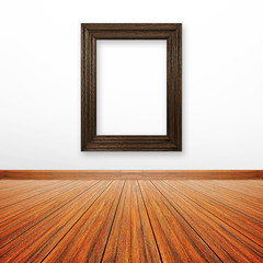 Wooden picture frame on the wall inside the room