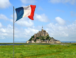 Mont Saint Michele with French flag , France