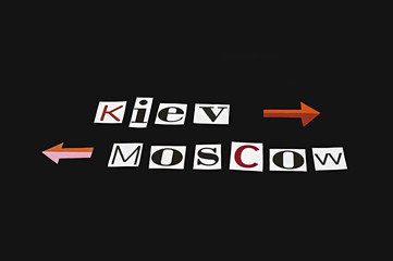 Kiev and Moscow words clipped from magazines on black background