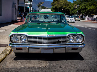 Classic Chevrolet in green serving as a taxi in Santa Barbara, C Wall mural