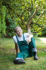 Gardener resting in orchard