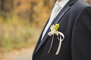 Buttonhole in a pocket of the groom