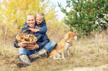 Family leisure in autumn forest