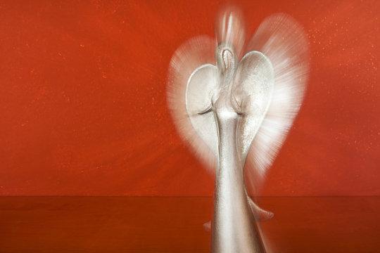 Upper body of a silver angel figure as a phenomenon